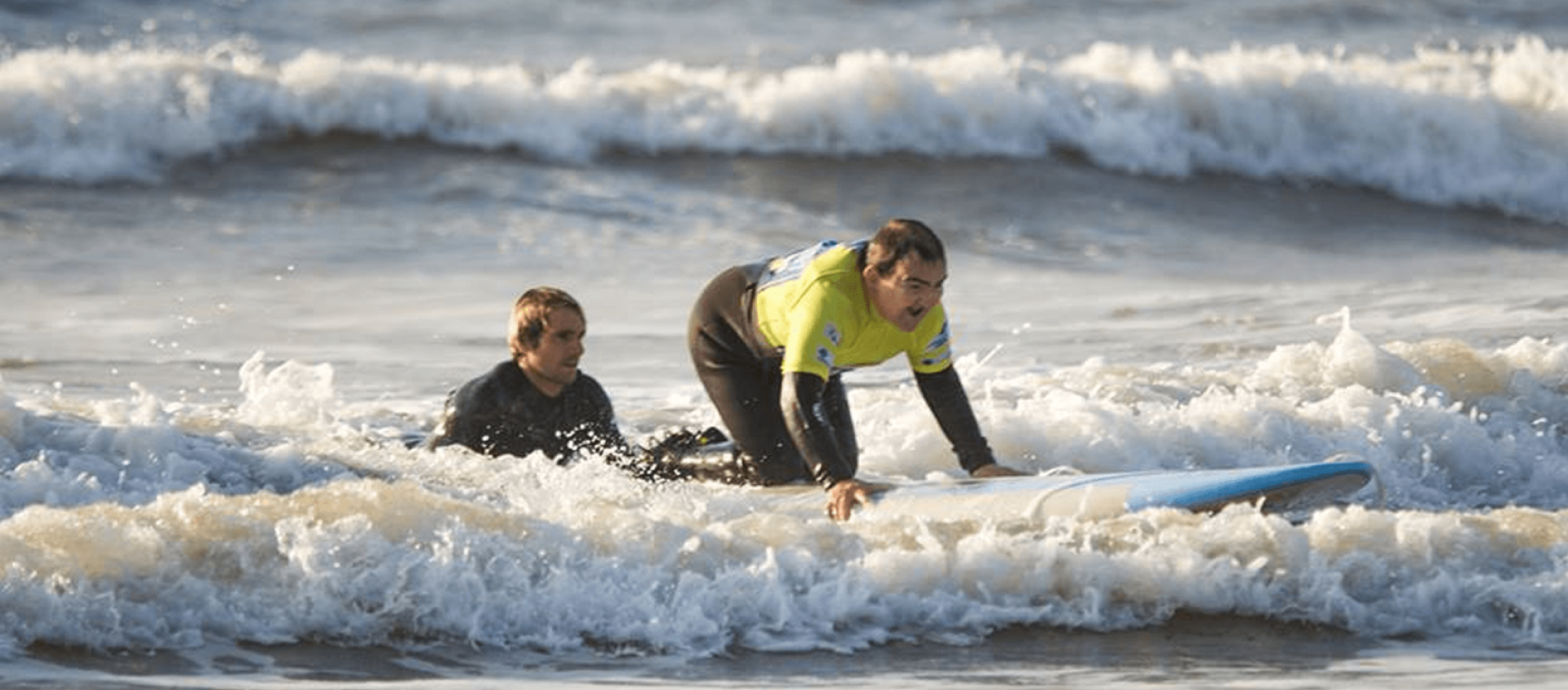 Men trying to surf